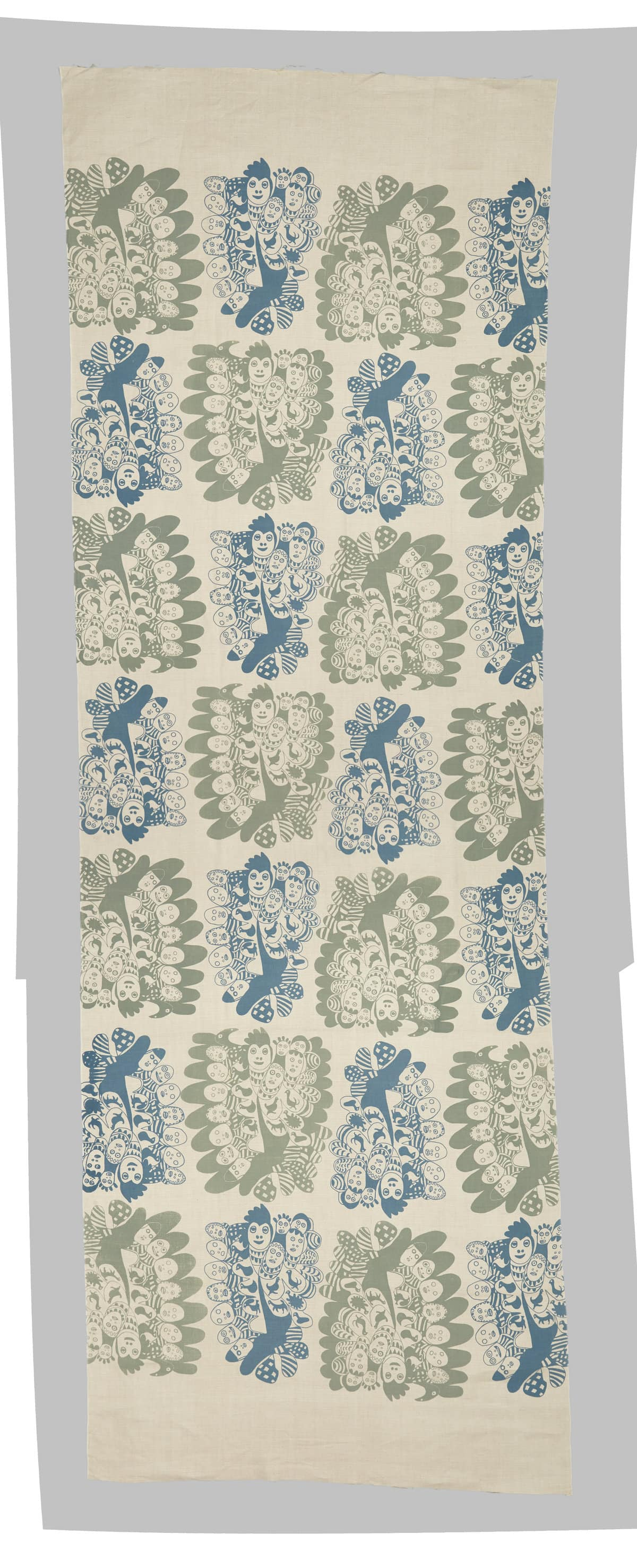 Image description: Artwork of green and blue birds surrounded by faces, printed on a cream-coloured fabric.